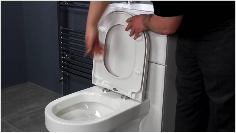 how to fix self closing toilet seat